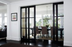 By sliding glass doors in