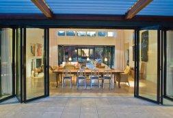 Accordion glass doors on