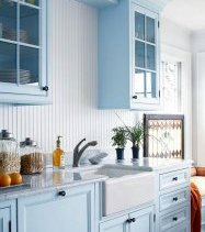 painted blue cabinets orb hardware bhg