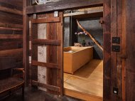 Stunning bathroom with sliding barn door and Japanese soaking tub [From: KuDa Photography]